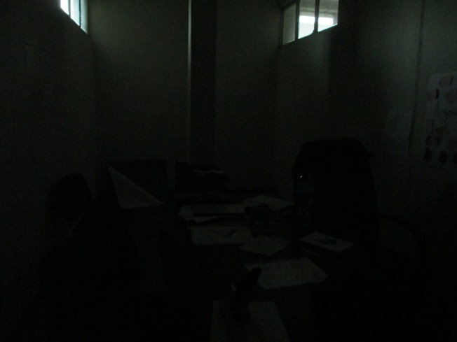 This is what my office looks like in the middle of the day when there's no electricity.  There are no windows to the outside world, just to neighbouring offices.
